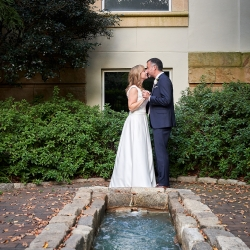 Critsey Rowe Photography captures a bride and groom sharing a sweet kiss before their wedding ceremony at The Mint Museum Randolph