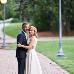 Bride and groom pose among the paths of the Mint Museum Randolph during their wedding in Charlotte, North Carolina