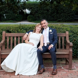 Bride and groom share a sweet moment during their wedding coordinated by Magnificent Moments Weddings and captured by Critsey Rowe Photography