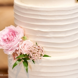 Soft flowers were the perfect accents to a white three tiered cake created by Suarez Bakery