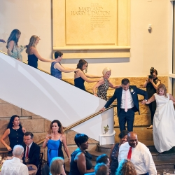 Bride and groom walk into their fun reception full of music from Crackerjack Sound Decisions