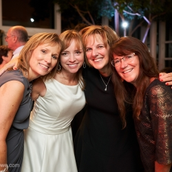 Bride shares a moment with some of her wedding guests during her wedding reception filled with music from Crackerjack Sound Decisions