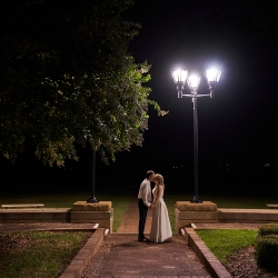 Bride and groom share a kiss at their end of their wedding captured by Critsey Rowe Photography