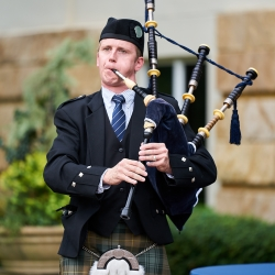 A bag piper placed music during a wedding ceremony at The Mint Museum Randolph