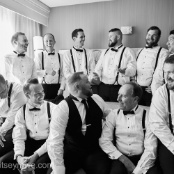 Critsey Rowe Photography captures a groom and his groomsmen having a good time before exchanging vows at The Mint