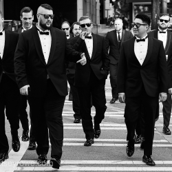 Groom and his groomsmen make their way to their wedding ceremony at The Mint