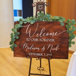 Critsey Rowe Photography captures a welcome sign welcoming guests into a ceremony at The Mint Uptown