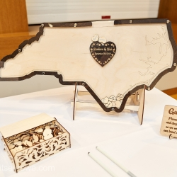 Custom guestbook allowed guests to share their well wishes with the bride and groom during their summer wedding coordinated by Magnificent Moments Weddings