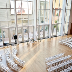 Rounded seating and large windows brought the city in for a wedding in Charlotte, North Carolina captured by Critsey Rowe Photography