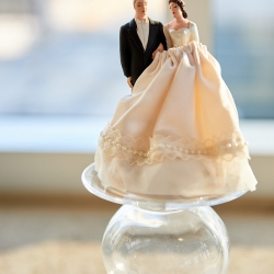 Bride used her families vintage cake topper during her modern uptown wedding coordinated by Magnificent Moments Weddings