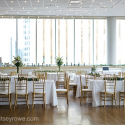 Crisp white linens, gold chavari chairs, and stunning floral centerpieces are the perfect accents to an uptown wedding at The Mint