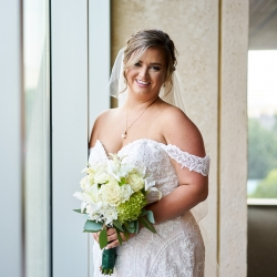 Critsey Rowe Photography captures a bride holding a stunning bouquet created by the Charlotte Farmers Market