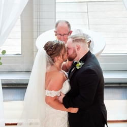 Bride and groom kiss following their vows in a ceremony in Uptown Charlotte, North Carolina