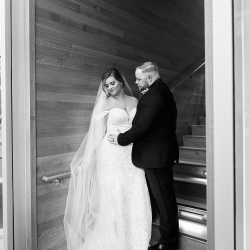 Bride and groom share a sweet moment during their Mint Museum Uptown wedding coordinated by Magnificent Moments Weddings