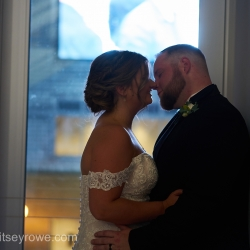Bride and groom share a kiss after their wedding ceremony at The Mint Uptown coordinated by Magnificent Moments Weddings