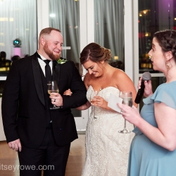 Maid of honor shares a fun story about the bride during a summer wedding reception in Uptown Charlotte