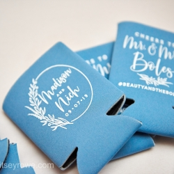 Custom koozies were a fun touch for guests to enjoying during a summer wedding in Uptown Charlotte coordinated by Magnificent Moments Weddings