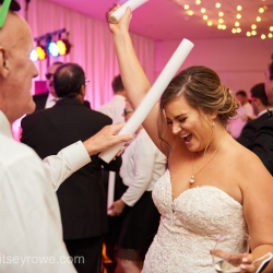 Bride dances with her guests to live music by Bounce Party Band during her summer wedding at The Mint Museum Uptown