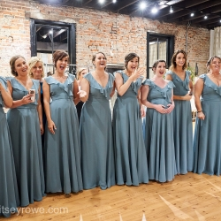 Bridesmaids react to a first look during as they get ready at Hayden Olivia Bridal Suite
