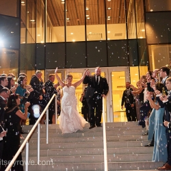 Bride and groom exit through bubbles from their Uptown Charlotte wedding coordinated by Magnificent Moments Weddings