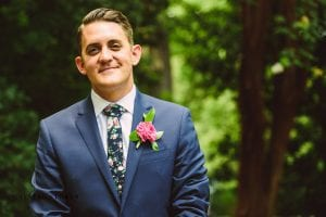 Crystal Stokes captures a groom as he sees his bride walk down the aisle during their outdoor ceremony at The Duke Mansion