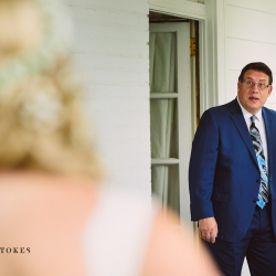 Bride shares a first look with her father captured by Crystal Stokes Photography during an outdoor wedding at The Duke Mansion