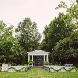 Stunning outdoor ceremony space at The Duke Mansion features a simple white arch accented with handmade cranes all captured by Crystal Stokes Photography
