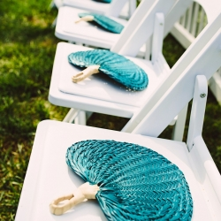 Guests were given fans to cool off during an outdoor wedding at The Duke Mansion in Charlotte North Carolina