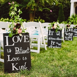 Meaningful quotes lined the aisle as a bride and groom made their way to their ceremony at The Duke Mansion