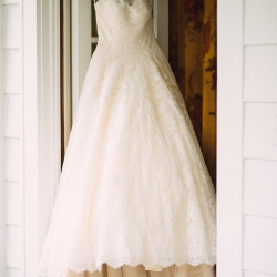Stunning bridal gown with lace overlay captured by Crystal Stokes Photography for a wedding at The Duke Mansion