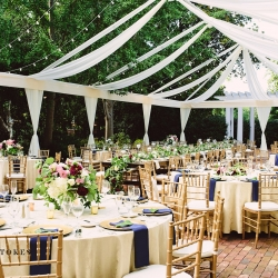 Open tent at the Duke Mansion served as the setting of a garden wedding with gold chiavari chairs all rented from Party Reflections