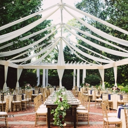 Stunning open tent served as the site for a garden wedding at The Duke Mansion coordinated by Magnificent Moments Weddings