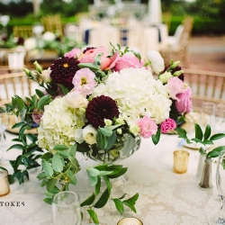 White hydrangeas are accented with blush and burgundy flowers for a garden wedding coordinated by Magnificent Moments Weddings