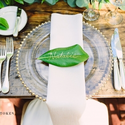Leaves served at table settings for a garden wedding at The Duke Mansion place setting included glass chargers and simple white napkins