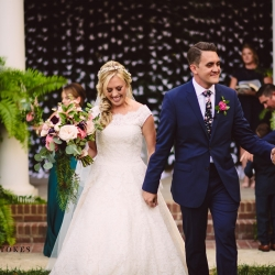 Bride and groom leave their Duke Mansion ceremony all smiles after exchanging vows