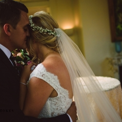 Bride and groom embrace before their Duke Mansion Wedding captured by Crystal Stokes Phtotography