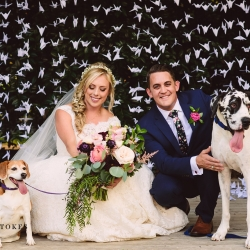 Bride and groom pose with their dogs during their garden wedding at The Duke Mansion coordinated by Magnificent Moments Weddings