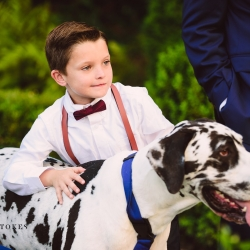 Ringer barer poses with the bride and grooms dog who was handled by Barks and Blooms during a fall wedding in Charlotte, North Carolina