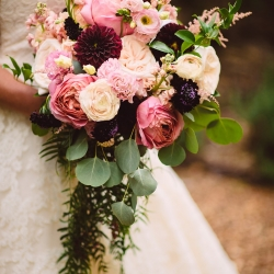 Bridal bouquet created by Lily Greenthumbs features stunning blush tones and lush greenery accents all for a garden wedding at The Duke Mansion