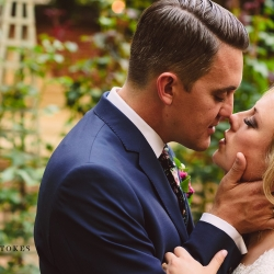 Bride and groom share a kiss in the garden of The Duke Mansion during their wedding captured by Crystal Stokes Photography