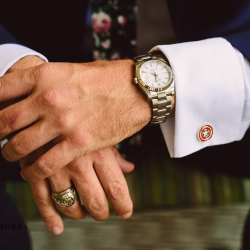 Crystal Stokes Photography captures a detail shot of a grooms including his Captain America cuff links as he prepares for his wedding at The Duke Mansion