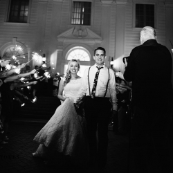 Bride and groom exit through sparklers during their fall wedding at The Duke Mansion