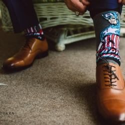 Groom dons Captain America socks for his wedding at the Duke Mansion