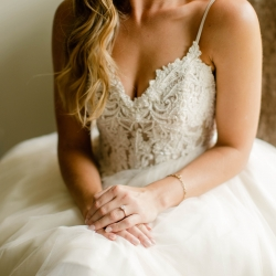 David Mendoza III Photography captures a detail shot showing off the lace bodice of a bride's stunning gown at Morning Glory Farms