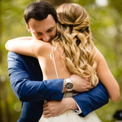 David Mendoza III Photography captures a bride and groom embracing after a first look coordinated by Magnificent Moments Weddings