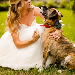 Bride poses with her dog wearing a floral collar created by Narcisse Greenway Designs