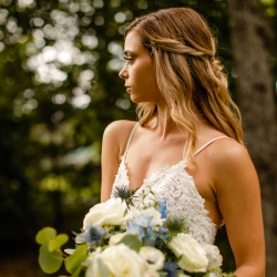 Bride shows of her stunning curls created by Jennifer Ambercrombie Beauty before her fall wedding at Morning Glory Farms
