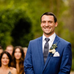 David Mendoza III Photography captures the smile on the grooms face as he walks down the aisle to meet his bride during their outdoor wedding at Morning Glory Farms