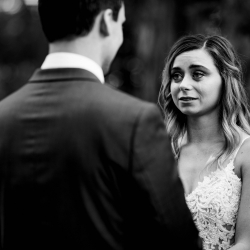 David Mendoza III Photography captures a bride as she exchanges vows with her groom during her fall wedding at Morning Glory Farms