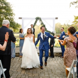 Bride and groom walk down the aisle after exchanging vows during their wedding ceremony coordinated by Magnificent Moments Weddings